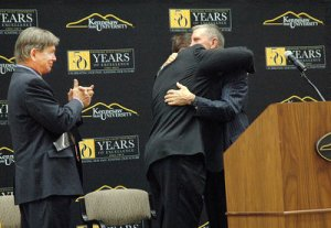 Sam Bracken embraces his old coach Bill Curry, who offered Bracken a football scholarship 40 years ago to play  Georgia Tech.
